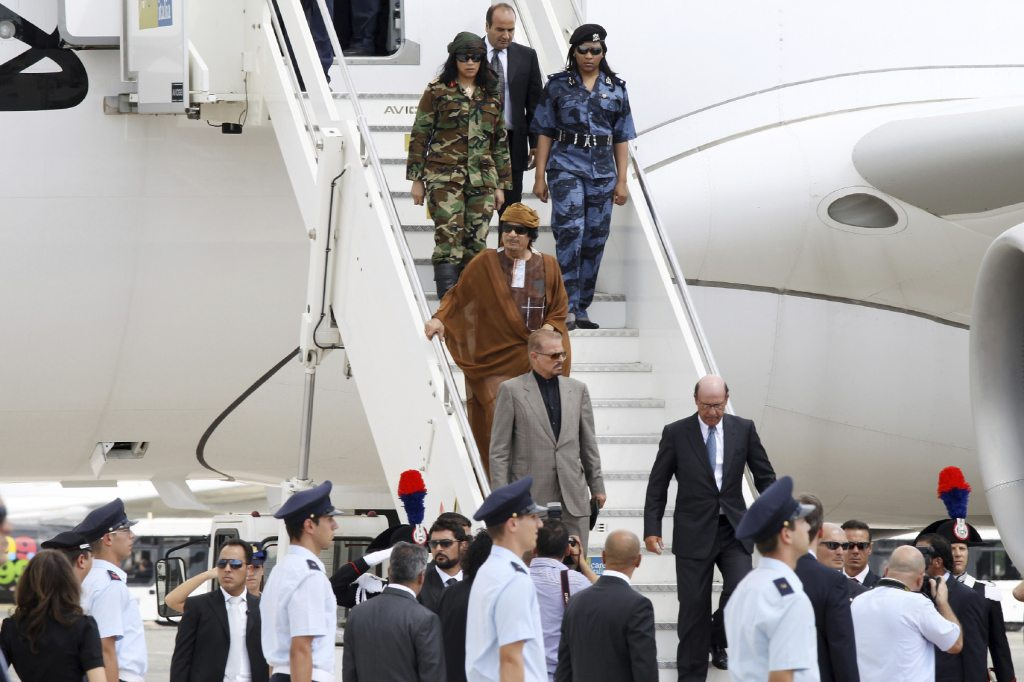 Libyan Leader Muammar Gaddafi climbing off his A340
