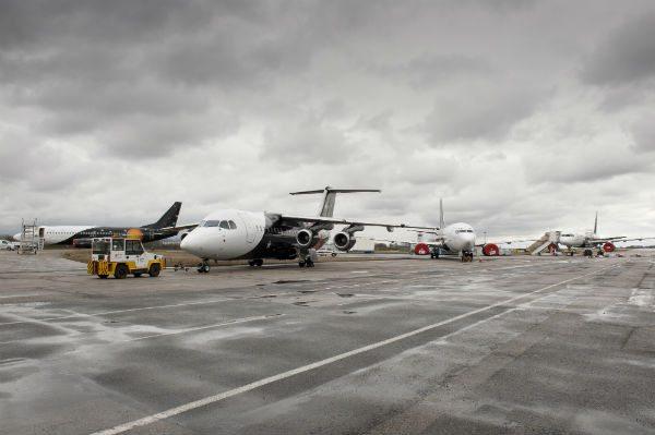The last Titan Airways BAe 146 being towed
